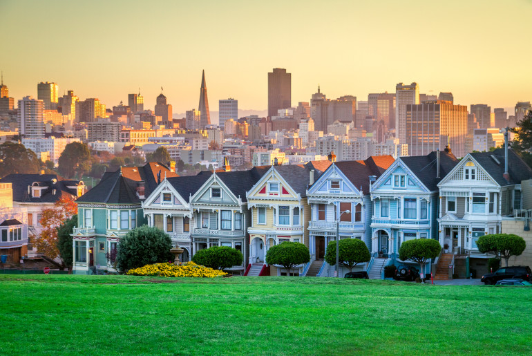 Classic shot of Victorian houses across the street from Alamo Square in San Francisco.