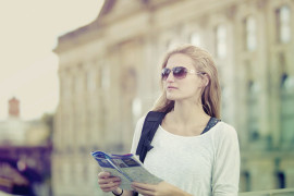 Young woman in the city holding a map. Berlin, Germany.